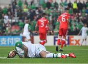23 March 2019; Shane Duffy of Republic of Ireland lies injured on the floor during the UEFA EURO2020 Qualifier Group D match between Gibraltar and Republic of Ireland at Victoria Stadium in Gibraltar. Photo by Seb Daly/Sportsfile