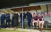 24 March 2019; Injured Galway player Damien Comer, third from right, and substitutes watch on during the Allianz Football League Division 1 Round 7 match between Tyrone and Galway at Healy Park in Omagh. Photo by David Fitzgerald/Sportsfile