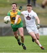 24 March 2019; Leo McLoone of Donegal in action against Jimmy Hyland of Kildare during the Allianz Football League Division 2 Round 7 match between Donegal and Kildare at Fr. Tierney Park in Ballyshannon, Donegal. Photo by Oliver McVeigh/Sportsfile