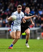 24 March 2019; Killian Clarke of Cavan in action against Ciaran Kilkenny of Dublin during the Allianz Football League Division 1 Round 7 match between Cavan and Dublin at Kingspan Breffni in Cavan. Photo by Ray McManus/Sportsfile