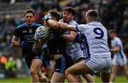 24 March 2019; Con O'Callaghan of Dublin is tackled by Conor Moynagh and Killian Clarke, 9, of Cavan during the Allianz Football League Division 1 Round 7 match between Cavan and Dublin at Kingspan Breffni in Cavan. Photo by Ray McManus/Sportsfile