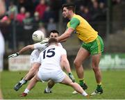 24 March 2019; Caolan McGonigle of Donegal in action against Eoin Doyle and Jimmy Hyland of Kildare during the Allianz Football League Division 2 Round 7 match between Donegal and Kildare at Fr. Tierney Park in Ballyshannon, Donegal. Photo by Oliver McVeigh/Sportsfile