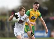 24 March 2019; Peter Kelly of Kildare in action against Jason McGee of Donegal during the Allianz Football League Division 2 Round 7 match between Donegal and Kildare at Fr. Tierney Park in Ballyshannon, Donegal. Photo by Oliver McVeigh/Sportsfile