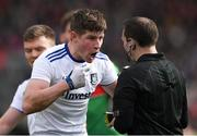 24 March 2019; Darren Hughes of Monaghan in conversation with referee Derek O'Mahoney before being shown a yellow card for a challenge on Mayo goalkeeper David Clarke during the Allianz Football League Division 1 Round 7 match between Mayo and Monaghan at Elverys MacHale Park in Castlebar, Mayo. Photo by Piaras Ó Mídheach/Sportsfile