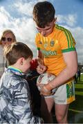 24 March 2019; Meath's Darragh Campion signing a ball for Bobby Mallon from Navan after the game with Daragh McCoy (7) and Riona McCoy (9) from Kentstown in the Allianz Football League Division 2 Round 7 match between Meath and Fermanagh at Páirc Tailteann in Navan, Co Meath. Photo by Philip Fitzpatrick/Sportsfile