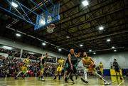 24 March 2019; Mike Garrow of UCD Marian in action against Kieran Donaghy of Garvey's Tralee Warriors during the Basketball Ireland Men's Superleague match between Garvey's Warriors Tralee and UCD Marian in the Tralee Sports Complex in Tralee, Co. Kerry. Photo by Diarmuid Greene/Sportsfile