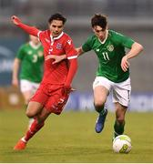 24 March 2019; Neil Farrugia of Republic of Ireland in action against Clayton Duarte of Luxembourg during the UEFA European U21 Championship Qualifier Group 1 match between Republic of Ireland and Luxembourg in Tallaght Stadium in Dublin. Photo by Ben McShane/Sportsfile