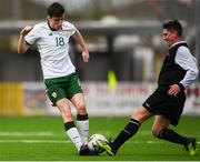 25 March 2019; Simon Falvey of Colleges & Universities in action against Paul Sheehan of Defence Forces during the match between Colleges & Universities and Defence Forces at  Athlone Town Stadium in Athlone, Co. Westmeath. Photo by Harry Murphy/Sportsfile