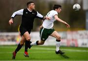 25 March 2019; Simon Falvey of Colleges & Universities in action against Scott Delaney of Defence Forces during the match between Colleges & Universities and Defence Forces at  Athlone Town Stadium in Athlone, Co. Westmeath. Photo by Harry Murphy/Sportsfile
