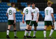 25 March 2019; Simon Falvey of Colleges & Universities, second right, celebrates after scoring his side's fourth goal with team-mates during the match between Colleges & Universities and Defence Forces at  Athlone Town Stadium in Athlone, Co. Westmeath. Photo by Harry Murphy/Sportsfile