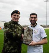 25 March 2019; Kieran McDaid of Colleges & Universities is presented the trophy by Brigadier General Peter O'Halloran the match between Colleges & Universities and Defence Forces at  Athlone Town Stadium in Athlone, Co. Westmeath. Photo by Harry Murphy/Sportsfile