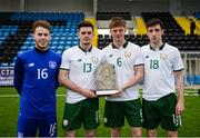 25 March 2019; UCC and Colleges & Universities players, from left, David Coffey, Pierce Phillips, Rob Slevin and Simon Falvey during the match between Colleges & Universities and Defence Forces at  Athlone Town Stadium in Athlone, Co. Westmeath. Photo by Harry Murphy/Sportsfile