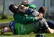 26 March 2019; Jack Carty, below, and Niyi Adeolokun during Connacht squad training at the Sportsground in Galway. Photo by Ramsey Cardy/Sportsfile