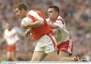 28 September 2003; Tony McEntee, Armagh, in action against Tyrone's Ryan McMenamin. Bank of Ireland All-Ireland Senior Football Championship Final, Armagh v Tyrone, Croke Park, Dublin. Picture credit; Matt Browne / SPORTSFILE *EDI*