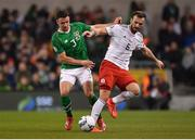 26 March 2019; Nika Kvekveskiri of Georgia in action against Enda Stevens of Republic of Ireland during the UEFA EURO2020 Group D qualifying match between Republic of Ireland and Georgia at the Aviva Stadium, Lansdowne Road, in Dublin. Photo by Seb Daly/Sportsfile