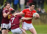 30 March 2019; Tommy Durnin of Louth in action against Kieran Martin and James Dolan of Westmeath during the Allianz Football League Roinn 3 Round 6 match between Louth and Westmeath at the Gaelic Grounds in Drogheda, Louth. Photo by Oliver McVeigh/Sportsfile