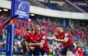 30 March 2019; Keith Earls of Munster celebrates with team-mates Peter O'Mahony and Rory Scannell after scoring his and his side's second try during the Heineken Champions Cup Quarter-Final match between Edinburgh and Munster at BT Murrayfield Stadium in Edinburgh, Scotland. Photo by Brendan Moran/Sportsfile