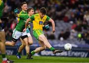 30 March 2019; Daire O'Donnell of Donegal shoots goalwards and wide under pressure from Shane Gallagher of Meath during the Allianz Football League Division 2 Final match between Meath and Donegal at Croke Park in Dublin. Photo by Ray McManus/Sportsfile