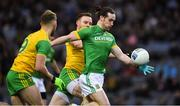 30 March 2019; Cillian O'Sullivan of Meath in action against Stephen McMenamin, left, and Eamonn Doherty of Donegal during the Allianz Football League Division 2 Final match between Meath and Donegal at Croke Park in Dublin. Photo by Ray McManus/Sportsfile