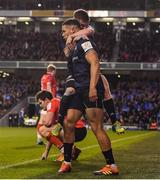 30 March 2019; Adam Byrne of Leinster celebrates with team-mate Luke McGrath, right, after scoring his side's second try during the Heineken Champions Cup Quarter-Final between Leinster and Ulster at the Aviva Stadium in Dublin. Photo by Ramsey Cardy/Sportsfile