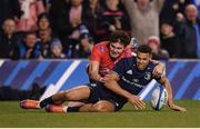30 March 2019; Adam Byrne of Leinster scores his side's second try despite the attention of Jacob Stockdale of Ulster during the Heineken Champions Cup Quarter-Final between Leinster and Ulster at the Aviva Stadium in Dublin. Photo by Stephen McCarthy/Sportsfile