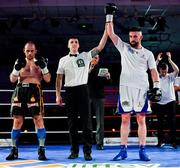 30 March 2019; Cillian Reardon, right, celebrates after winning his middleweight bout against Istvan Szucs at the National Stadium in Dublin. Photo by Seb Daly/Sportsfile