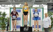 30 March 2019;  Girls Under 13 60m medallists, from left, Anna Taylor of Crookstown Millview A.C., Co. Kildare, bronze, Ella Curtin of Brothers Pearse A.C., Co. Dublin, gold, and Riona Doherty of Finn Valley A.C., Co. Donegal, silver, with Athletics Ireland President Georgina Drumm during Day 1 of the Irish Life Health National Juvenile Indoor Championships at AIT in Athlone, Co Westmeath. Photo by Sam Barnes/Sportsfile