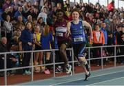 31 March 2019; Jordan Kissane of Tralee Harriers A.C., Co. Kerry, right, on his way to winning the Under 17 200m event, ahead of Charles Okafor of Mullingar Harriers A.C., Co. Westmeath,  during Day 2 of the Irish Life Health National Juvenile Indoor Championships at AIT in Athlone, Co Westmeath. Photo by Sam Barnes/Sportsfile