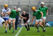 31 March 2019; Jack Prendergast of Waterford and Kyle Hayes of Limerick battle for possession as Limerick players Tom Morrissey and Aaron Gillane, right, look on alongside linesman Seán Cleere during the Allianz Hurling League Division 1 Final match between Limerick and Waterford at Croke Park in Dublin. Photo by Piaras Ó Mídheach/Sportsfile