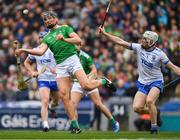 31 March 2019; Gearóid Hegarty of Limerick scores a late point under pressure from Shane McNulty of Waterford during the Allianz Hurling League Division 1 Final match between Limerick and Waterford at Croke Park in Dublin. Photo by Ray McManus/Sportsfile