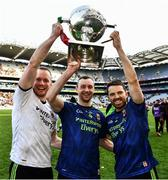 31 March 2019; Mayo goalkeeper Rob Hennelly celebrates with team-mates Keith Higgins and Chris Barrett, right, and the cup after the Allianz Football League Division 1 Final match between Kerry and Mayo at Croke Park in Dublin. Photo by Ray McManus/Sportsfile