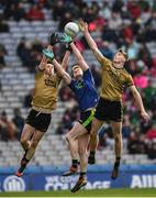 31 March 2019; Jason Doherty of Mayo, Paul Murphy and Diarmuid O'Connor of Kerry jump to try and catch the ball during the Allianz Football League Division 1 Final match between Kerry and Mayo at Croke Park in Dublin. Photo by Ray McManus/Sportsfile
