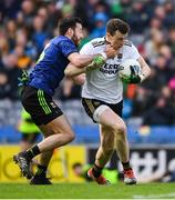 31 March 2019; Kevin McLoughlin of Mayo tackles the Kerry goalkeeper Shane Ryan during the Allianz Football League Division 1 Final match between Kerry and Mayo at Croke Park in Dublin. Photo by Ray McManus/Sportsfile
