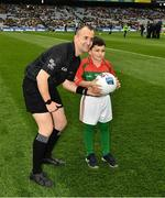30 March 2019; Referee Brendan Cawley with Kaya Taz, Drumcong NS, and the Kiltubrid Club, Co. Leitrim, before the Allianz Football League Division 4 Final between Derry and Leitrim at Croke Park in Dublin. Photo by Ray McManus/Sportsfile
