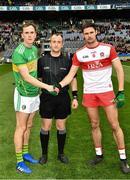 30 March 2019; Referee Brendan Cawley with the Leitrim captain, Micheal McWeeney, and the Derry captain, Christopher McKaigue, before the Allianz Football League Division 4 Final between Derry and Leitrim at Croke Park in Dublin. Photo by Ray McManus/Sportsfile