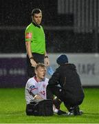 1 April 2019; Gary Shaw of St Patrick's Athletic receives treatment during the EA Sports Cup Second Round match between St. Patrick's Athletic and Dundalk at Richmond Park in Dublin. Photo by Seb Daly/Sportsfile