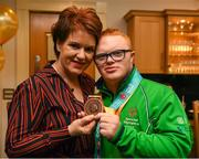 3 April 2019; Team Ireland's Fergal Gregory, a member of the Newry City SOC, from Newry, Co. Down with his mother Áine when Team Ireland athletes visited Leinster House to celebrate their success at the recent World Summer Games Abu Dhabi. Photo by Ray McManus/Sportsfile
