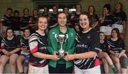 30 March 2019; Portlaoise captains Alison Kelly and Meabh Carroll are presented with the cup by Eve Higgins of Ireland and Leinster after the Leinster Rugby Girls U16 Girls Plate Final match between Greystones and Portlaoise at Navan RFC in Navan, Co Meath. Photo by Matt Browne/Sportsfile