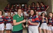 30 March 2019; Clontarf captain Maeve Keegan is presented with the cup by Eve Higgins of Ireland and Leinster after the Leinster Rugby Girls U16 Girls Conference Final match between Clontarf and MU Barnhall at Navan RFC in Navan, Co Meath. Photo by Matt Browne/Sportsfile