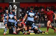 5 April 2019; Chris Farrell of Munster dives over to score his side's first try during the Guinness PRO14 Round 19 match between Munster and Cardiff Blues at Irish Independent Park in Cork. Photo by Ramsey Cardy/Sportsfile