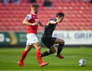 5 April 2019; Jamie McGrath of Dundalk in action against Conor Clifford of St Patrick's Athletic during the SSE Airtricity League Premier Division match between St Patrick's Athletic and Dundalk at Richmond Park in Dublin. Photo by Seb Daly/Sportsfile
