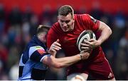 5 April 2019; Chris Farrell of Munster is tackled by Owen Lane of Cardiff Blues during the Guinness PRO14 Round 19 match between Munster and Cardiff Blues at Irish Independent Park in Cork. Photo by Ramsey Cardy/Sportsfile