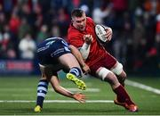5 April 2019; Peter O'Mahony of Munster is tackled by Owen Lane of Cardiff Blues during the Guinness PRO14 Round 19 match between Munster and Cardiff Blues at Irish Independent Park in Cork. Photo by Ramsey Cardy/Sportsfile