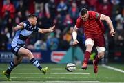 5 April 2019; Peter O'Mahony of Munster in action against Owen Lane of Cardiff Blues during the Guinness PRO14 Round 19 match between Munster and Cardiff Blues at Irish Independent Park in Cork. Photo by Ramsey Cardy/Sportsfile