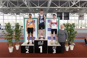 6 April 2019; Danny Kelly of Belgooly AC, Cork, who won gold in the boys under-16 long jump with second place Bobby Amadi of Dublin Striders AC and third place Conor Hoade of Galway City Harriers AC with Athletics Ireland President Georgina Drumm during Day 3 of the Irish Life Health National Juvenile Indoor Championships at AIT in Athlone, Co Westmeath. Photo by Matt Browne/Sportsfile