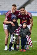 6 April 2019; Tommy McDaniel, left, and Noel Mulligan of Westmeath with five year old Tom and three year old Conor Adamson, from Moate, celebrate after the Allianz Football League Division 3 Final match between Laois and Westmeath at Croke Park in Dublin. Photo by Ray McManus/Sportsfile