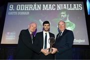 6 April 2019; Odhrán Mac Niallis of Gweedore is presented with his award by Uachtarán Chumann Lúthchleas Gael John Horan, right, and Denis O'Callaghan, Head of AIB Retail Banking, at the AIB GAA Club Player 2018/19 Awards at Croke Park in Dublin. Photo by Stephen McCarthy/Sportsfile