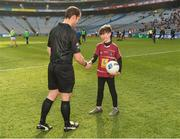 6 April 2019; Referee Jerome Henry with eleven year old Paul Keating, from Mullingar, who presented the ball  before the Allianz Football League Division 3 Final match between Laois and Westmeath at Croke Park in Dublin. Photo by Ray McManus/Sportsfile