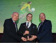 6 April 2019; Kieran Molloy of Corofin is presented with his Footballer of the Year award by Uachtarán Chumann Lúthchleas Gael John Horan, right, and Denis O'Callaghan, Head of AIB Retail Banking, at the AIB GAA Club Player 2018/19 Awards at Croke Park in Dublin. Photo by Stephen McCarthy/Sportsfile