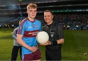 6 April 2019; Referee Rory Hickey presents the match ball to the captain of  St Michaels College Brandon Horan after the Masita GAA Post Primary Schools Hogan Cup Senior A Football match between Naas CBS and St Michaels College Enniskillen at Croke Park in Dublin. Photo by Ray McManus/Sportsfile